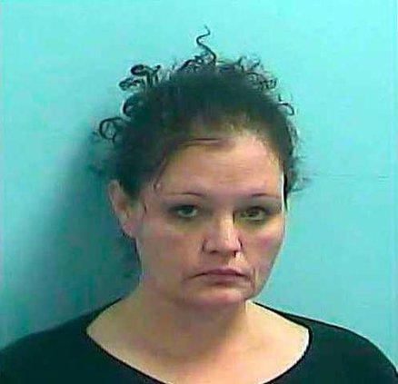 1 Woman charged Evans mug