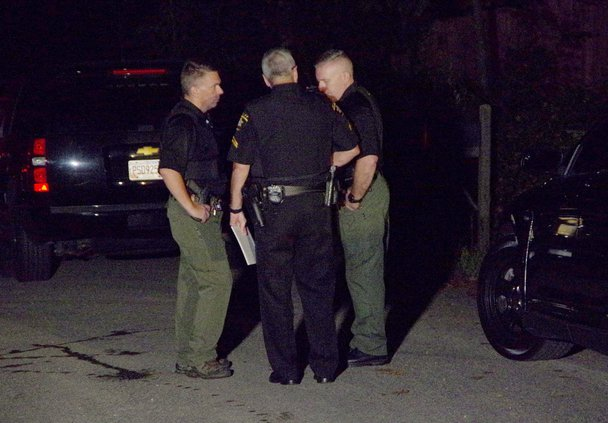 Deputies_talk_near_the_press_staging_area.original.jpg