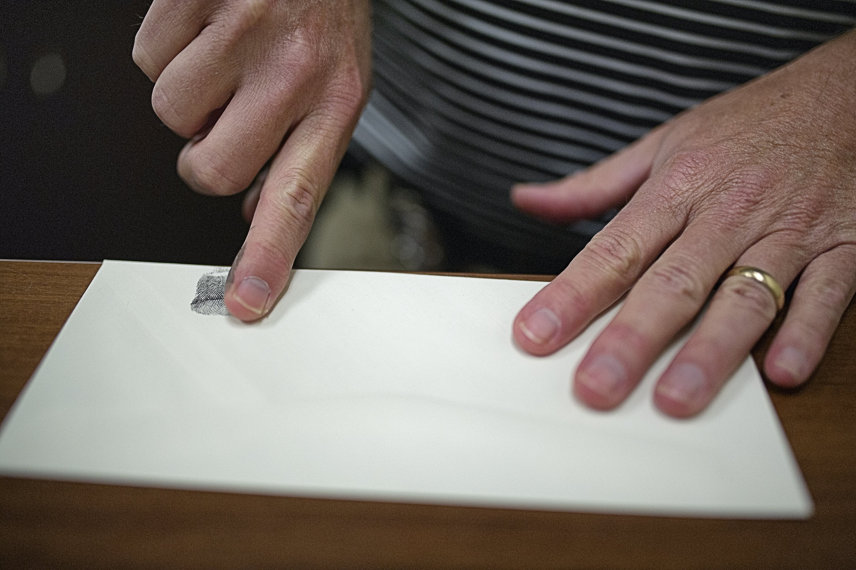 For fingerprint analyst, the devil is in the details